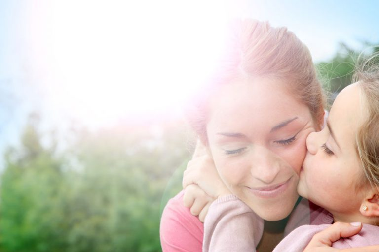 Daughter kissing Mom's Cheek