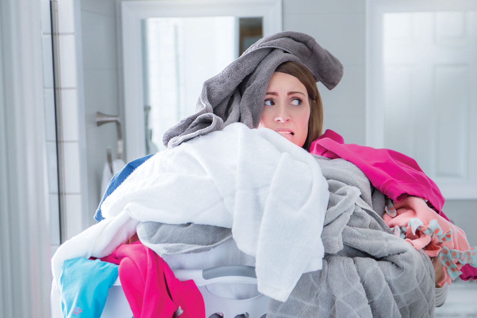Overwhelmed Woman with Laundry